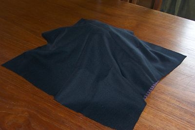 The Lenten table centrepiece remains covered with a black cloth.