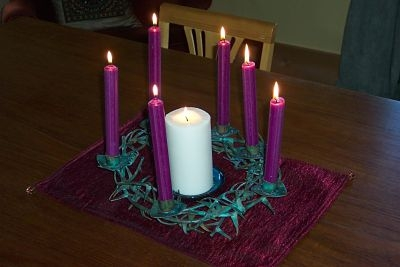 The lite Christ candle is surrounded by six lite purple candles.